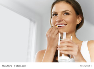 Vitamins. Healthy Diet, Eating, Lifestyle. Happy Smiling Woman Taking Pill With Cod Liver Oil Omega-3 And Holding A Glass Of Fresh Water. Healthcare And Beauty. Vitamin D, E, A Fish Oil Capsules. Nutrition.